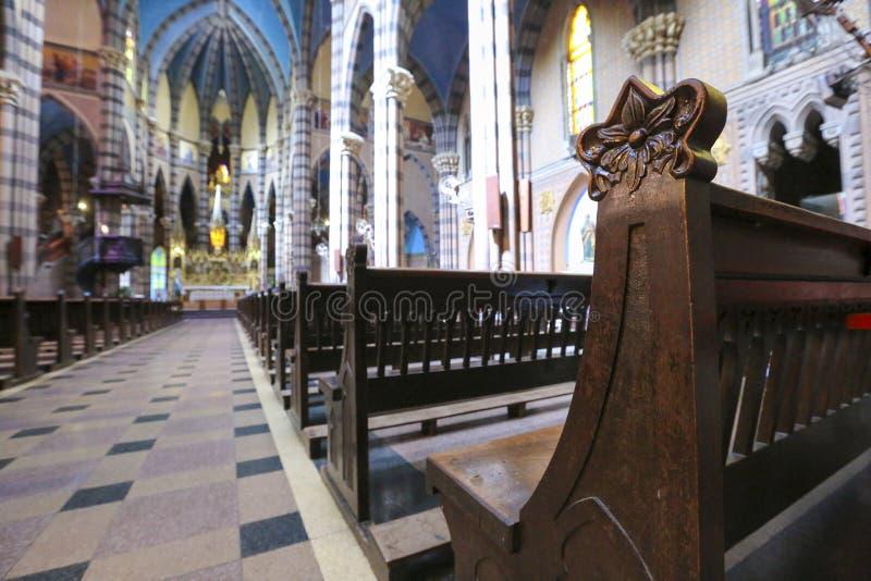 Capuchin Church, Cordoba (Argentina). Wooden bench details inside the colored interior of the Capuchins Church (Iglesia del Asacrado Corazon) in the center of stock photo