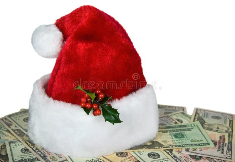 Capuchon de Santa sur l'argent comptant photo stock