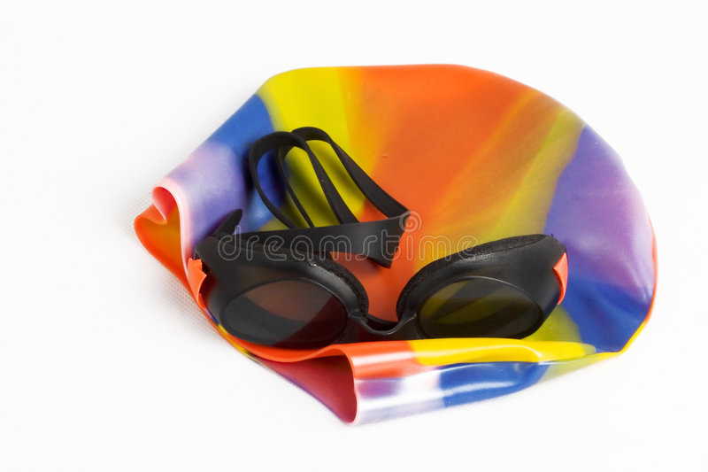Capuchon et lunettes de natation photo libre de droits