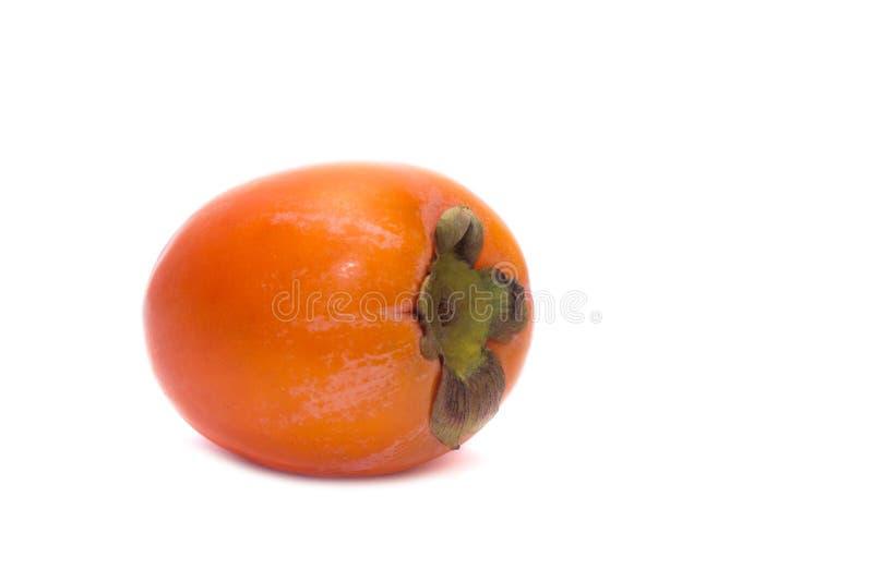 Caqui anaranjado, maduro, jugoso aislado en el fondo blanco fotografía de archivo