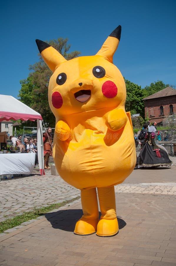 Caráter de Pikachu no evento cosplay da exposição fotografia de stock