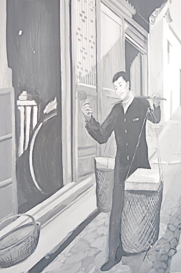 Caráteres açúcar-em mudança do cabelo da galinha do homem de negócios de China Zhejiang Yiwu que escolhem um chocalho girado manu foto de stock