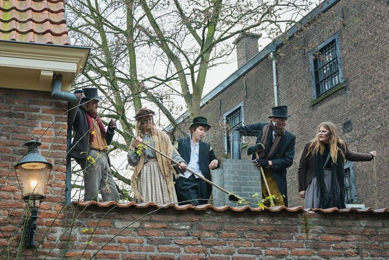 Caráteres dos livros famosos de Dickens durante o Dickens F fotografia de stock