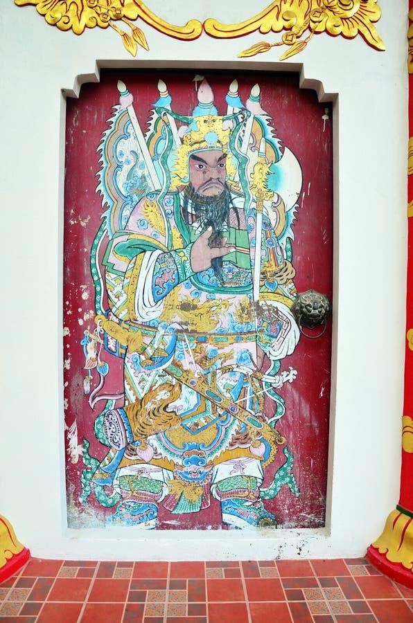 Caráteres tradicionais do deus da pintura chinesa na parede em Hat Yai imagem de stock