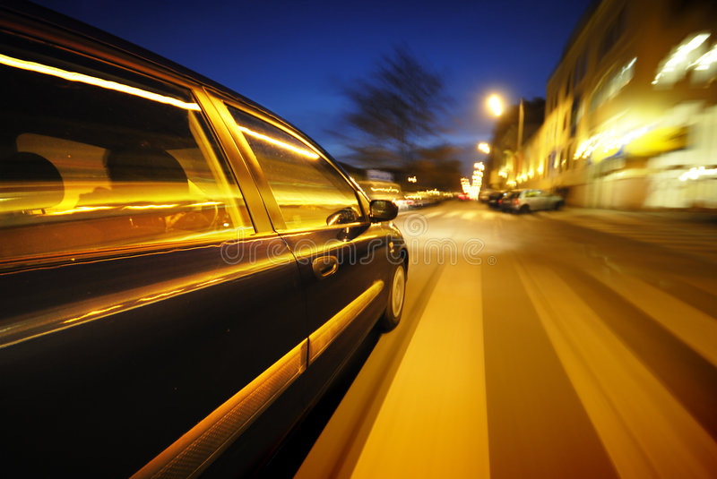 The Car. Moving Car at night in the lights stock photos