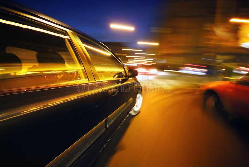 The Car. Moving Car at night in the lights stock image