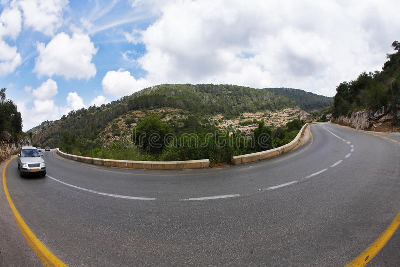 The car on abrupt turn. Of the mountain road, photographed by an objective Fish eye stock photography