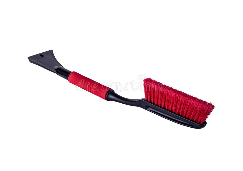 Car accessories for winter - plastic ice scrapers, red telescopic snow brushes with long handle on white background. Car accessories for the winter - plastic ice stock photo