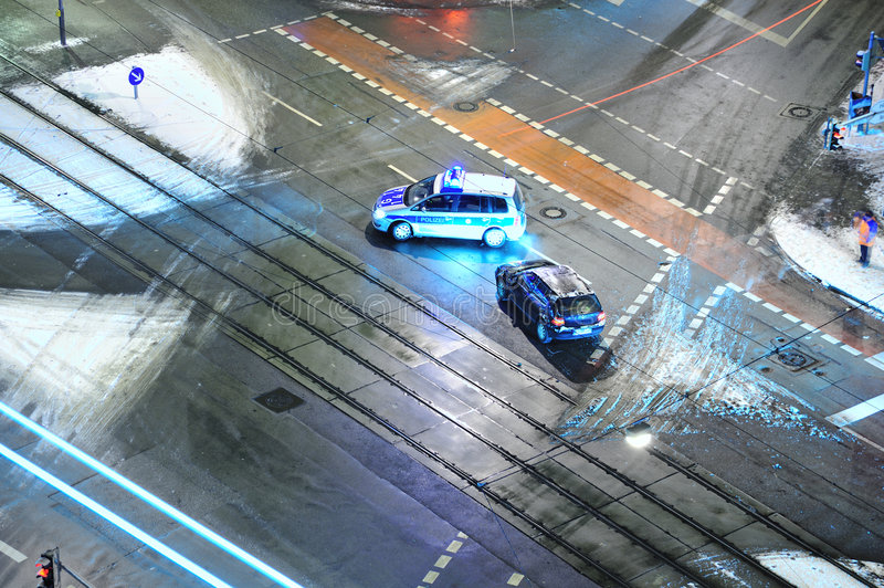 Car accident. German police at a car accident at crossroads in the winter royalty free stock photography