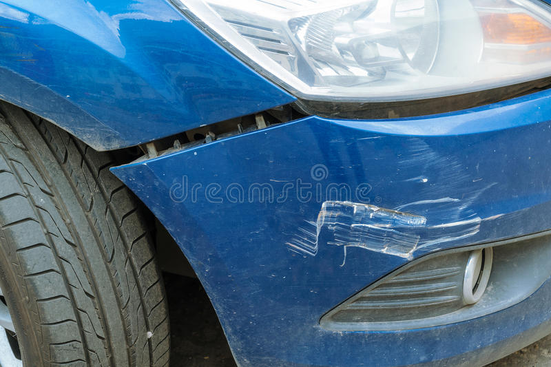 The car after the accident with a broken bumper. Between the fender and the bumper view of the crack. On the bumper are visible dings and scratches royalty free stock photography