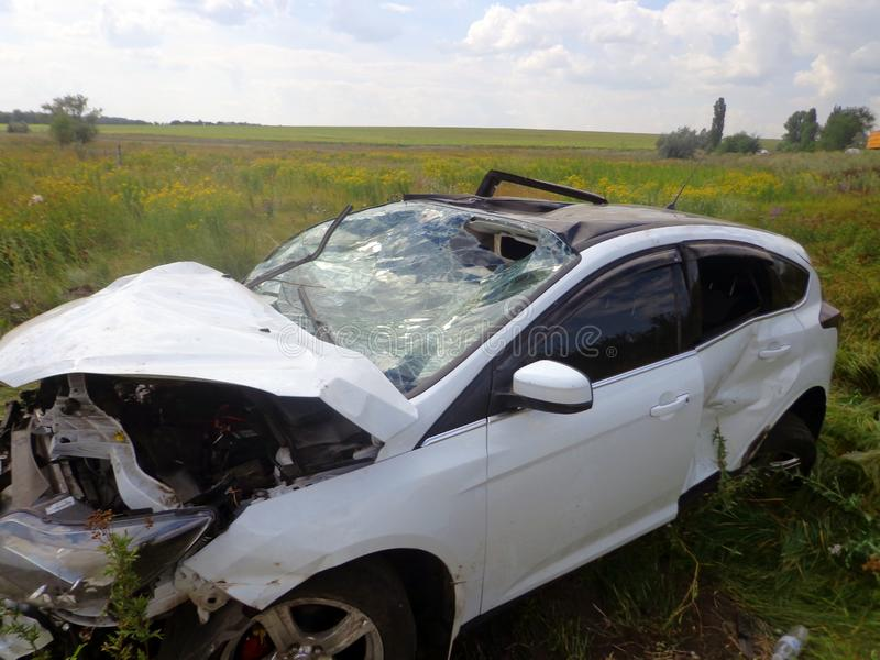 Car Accident  Broken Turned Over Car Lies Near Road Stock Image