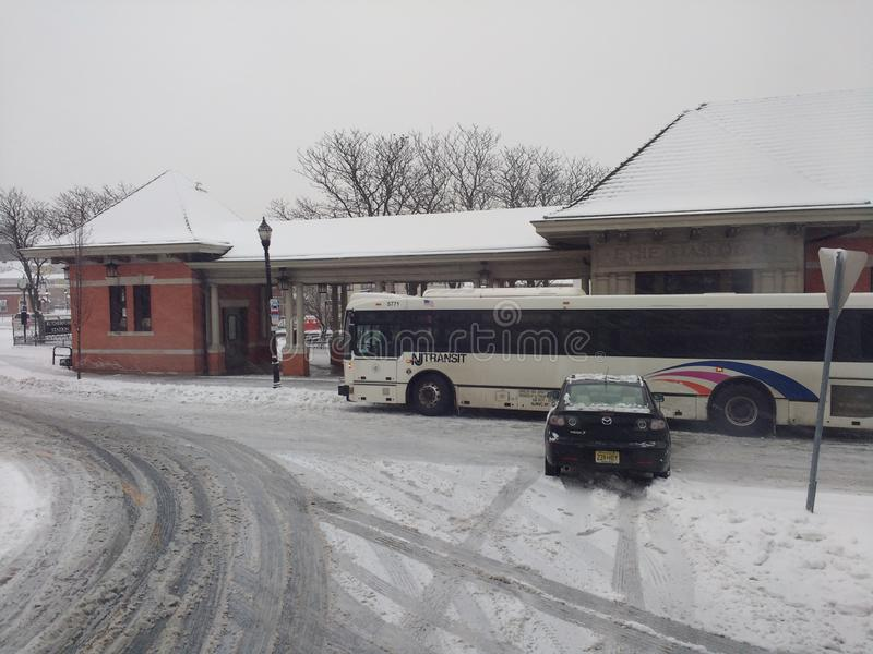 Car Accident Caused By Snow and Ice, Winter Weather, Inclement Weather, USA. A car hits a NJ Transit bus at Station Square in Rutherford, New Jersey, USA, during stock photo