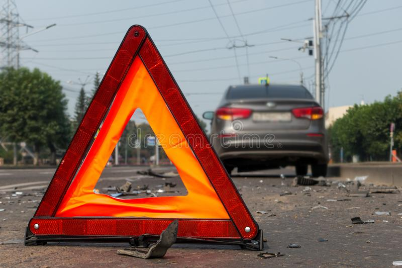 Car accident on a city street, road warning triangle sign.  stock photo