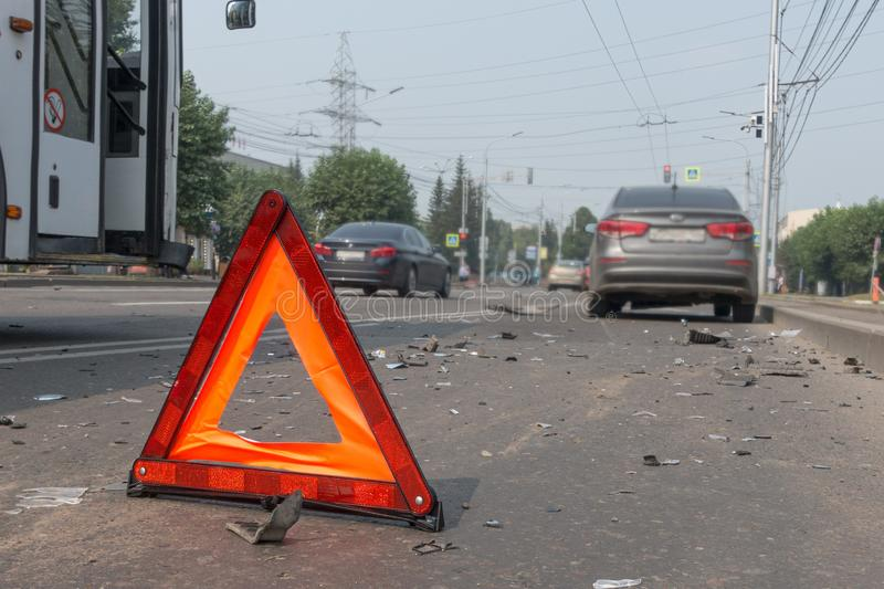 Car accident on a city street, road warning triangle sign.  stock image