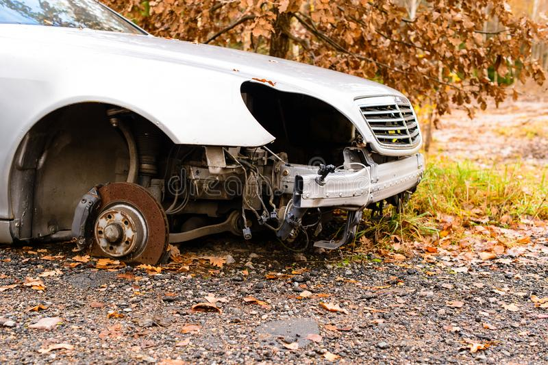 Car accident, damaged vehicle after crash staying on the road in royalty free stock images