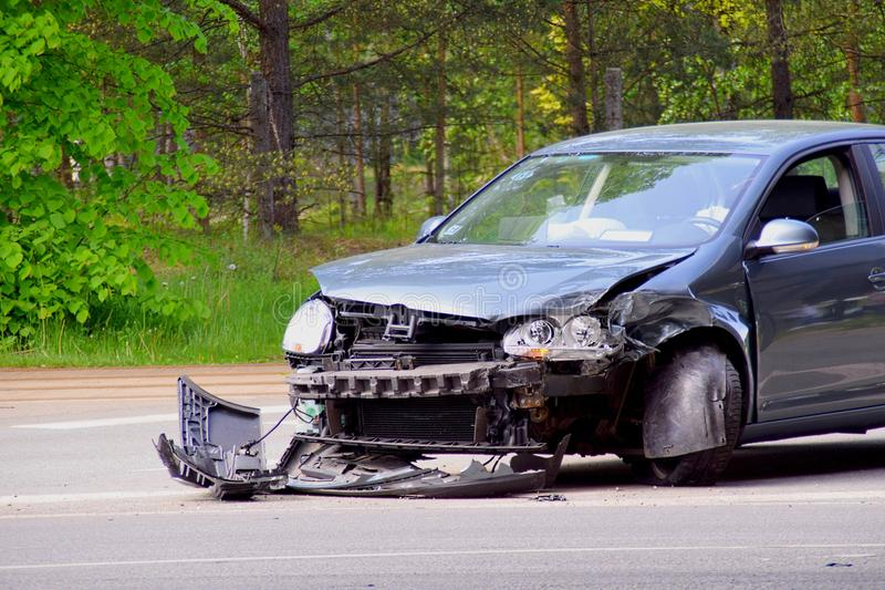 Car accident. On front of dark car royalty free stock photography