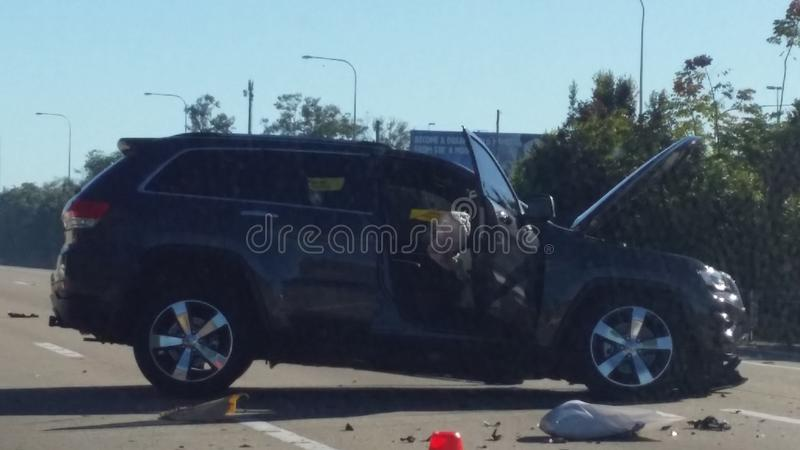 Car Accident. A horrific road accident involving a sport utility vehicle. The vehicle hit a road barrier while trying to exit the motorway or highway. Road stock photo