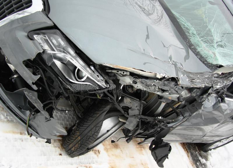 Car after an accident. Left front part of Audi Q5 following an accident with a truck stock image