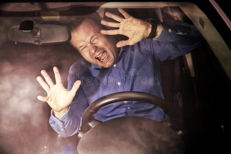 Car accident. Man driver during moment of car accident inside of a car (hard grunge effect stock image