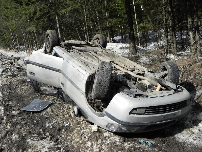 Car accident, overturned car. The accident happened in the winter on a slippery road. royalty free stock photos
