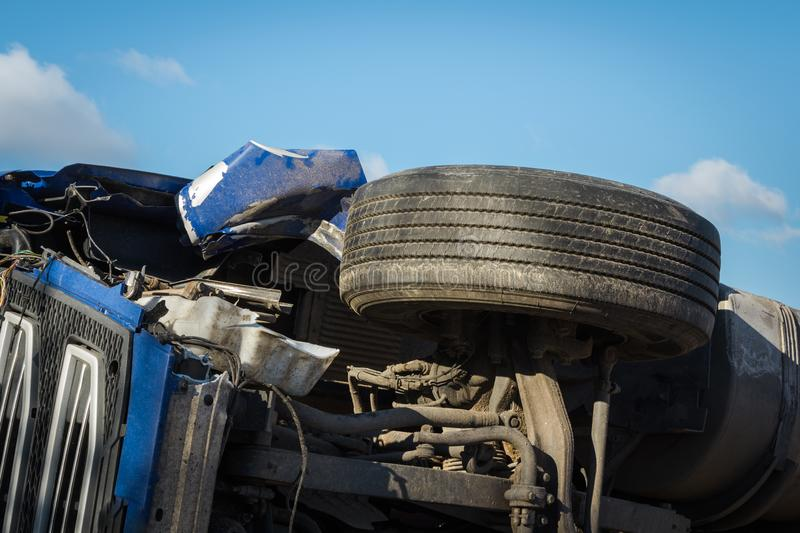 Car accident on a road in February 22, 2019, cargo vehicle drove off the road and turned upside down royalty free stock photography