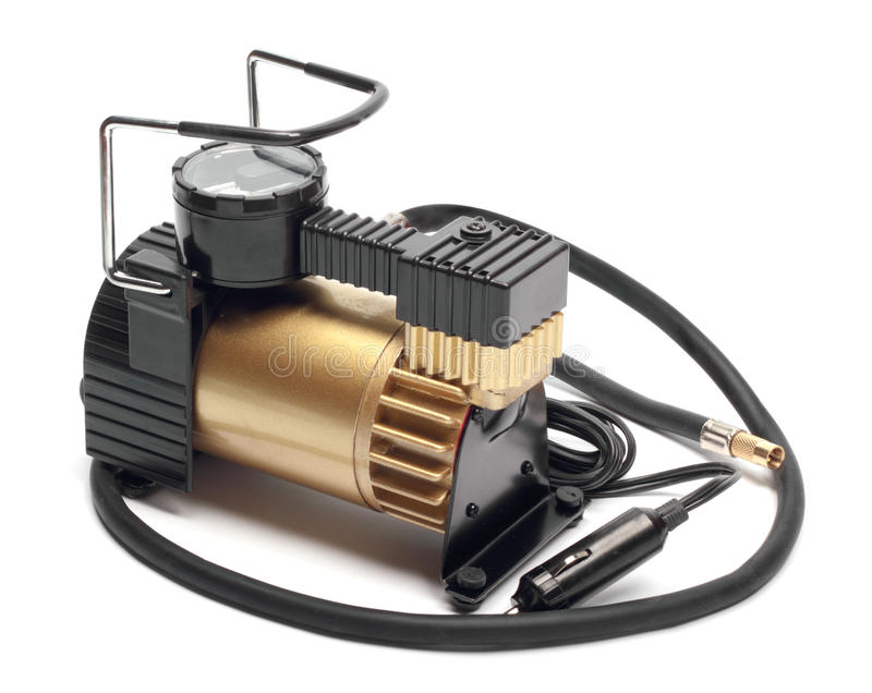 Car air compressor with manometer. Isolated on a white background royalty free stock photos