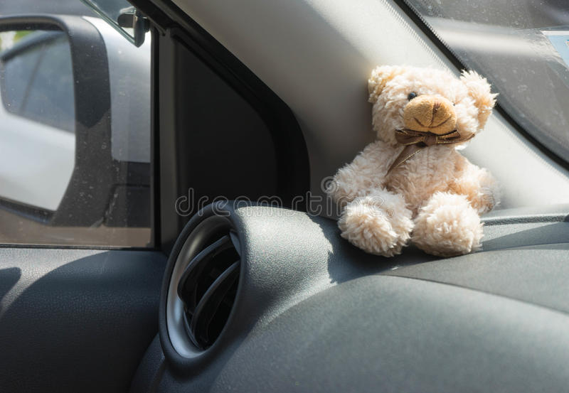 car air conditioner grid panel on console and teddy bear royalty free stock photos