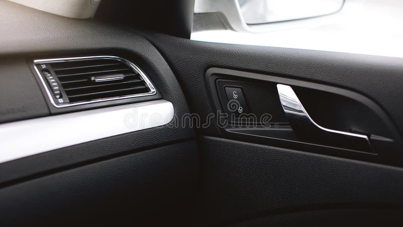 Car air conditioning. The air flow inside the car. Detail audio system buttons in car. stock photography