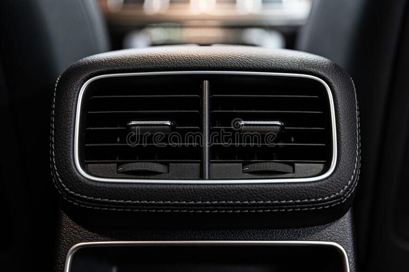 Car air vents and air conditioning. Modern car royalty free stock photo