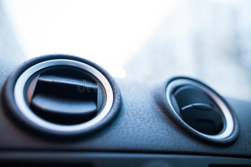 Car air vents detail. Close up shot of a the air vents inside a car stock photo
