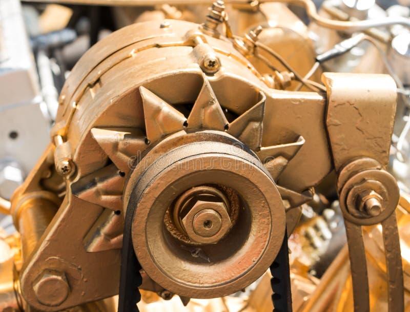 Car alternator, Converting Mechanical Energy to Electrical Energy Inside a Car. stock image