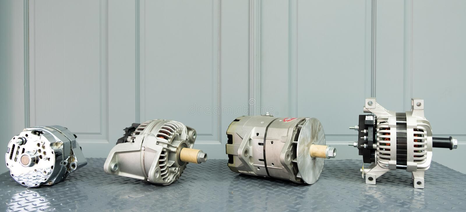 Car alternators on display on metal shelf/auto parts stock image