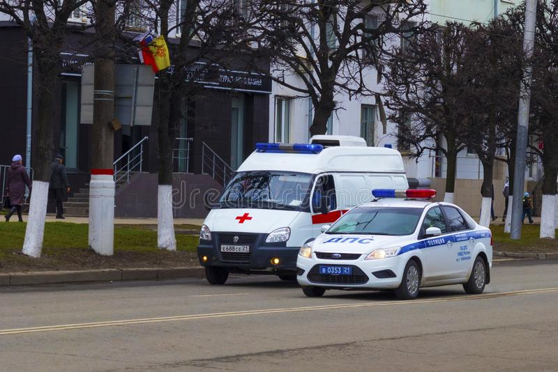 Car ambulance and road patrol service. City of Cheboksary, Chuvash Republic, Russia, 01/05/2018 stock photography