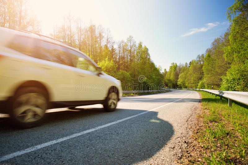 Car on asphalt road in beautiful spring day royalty free stock image