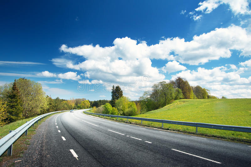 Car on asphalt road in beautiful spring day. At countryside stock photography