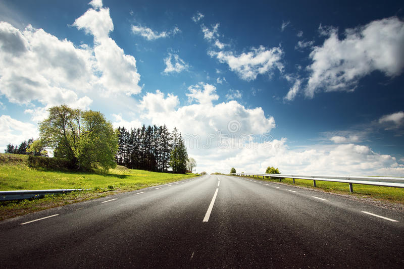 Car on asphalt road in beautiful spring day. At countryside royalty free stock image
