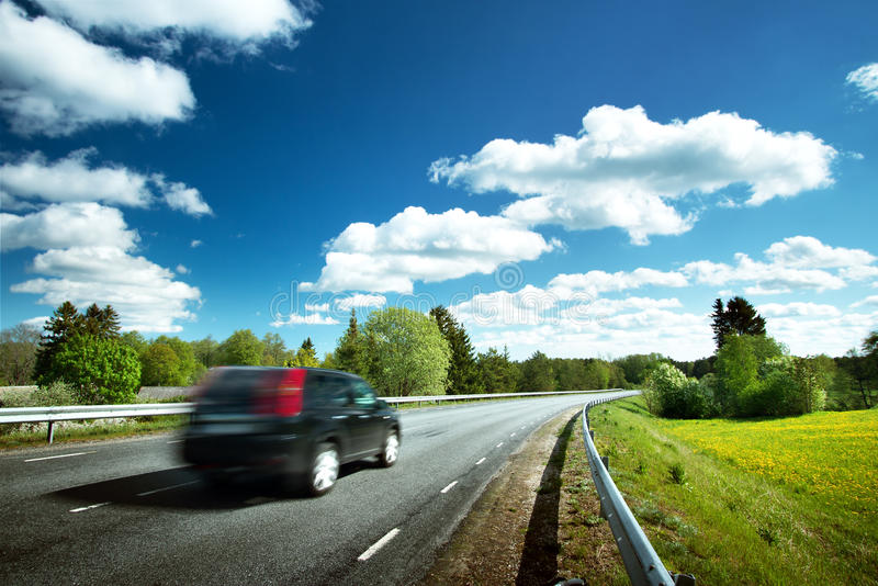 Car on asphalt road in beautiful spring day. At countryside royalty free stock photo