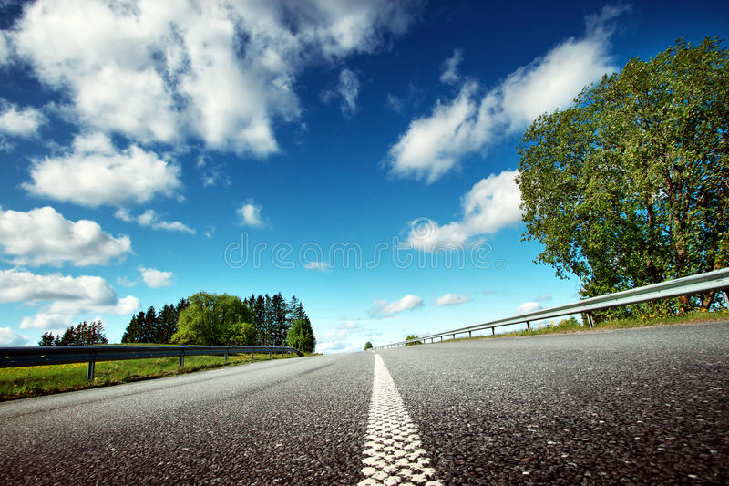 Car on asphalt road in beautiful spring day. At countryside royalty free stock photography