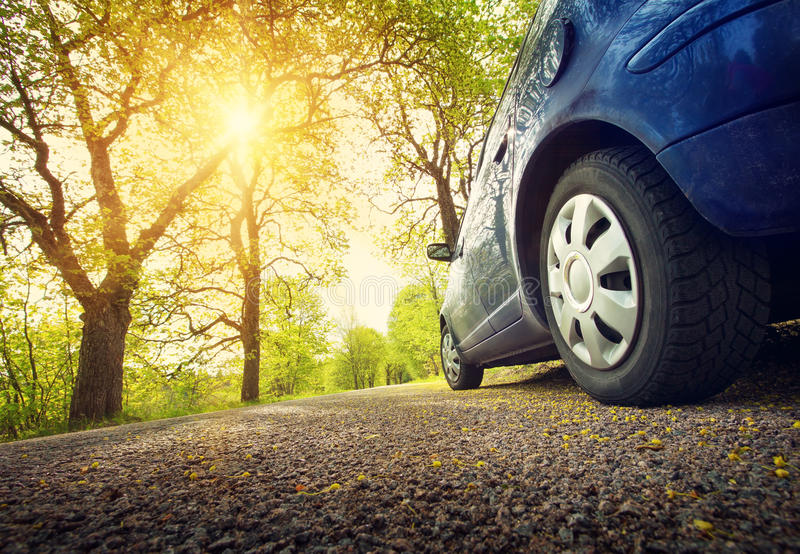 Car on asphalt road in spring stock photography