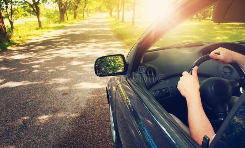 Car on asphalt road in summer royalty free stock photos