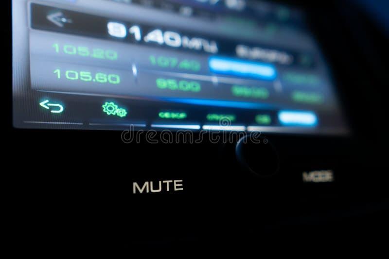 Car audio in mute mode. Closeup shot of screen of modern car audio working in mute mode stock images
