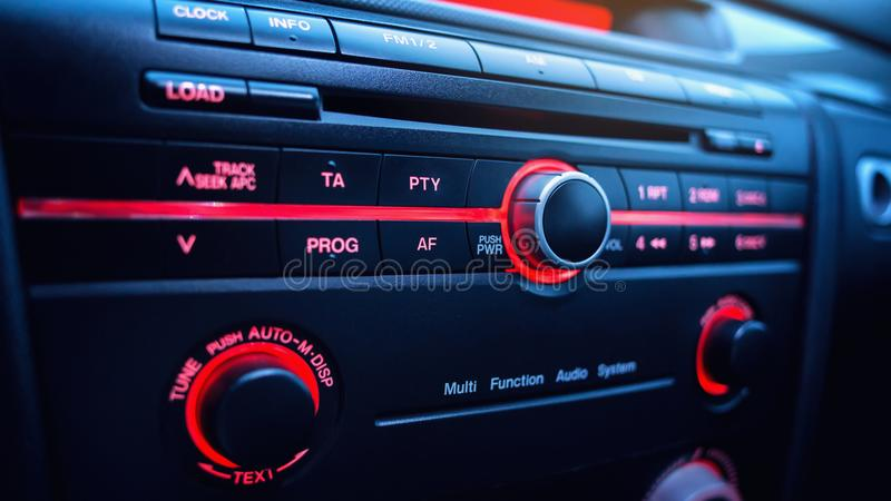 Car audio system. Button on dashboard in modern car panel. royalty free stock photo