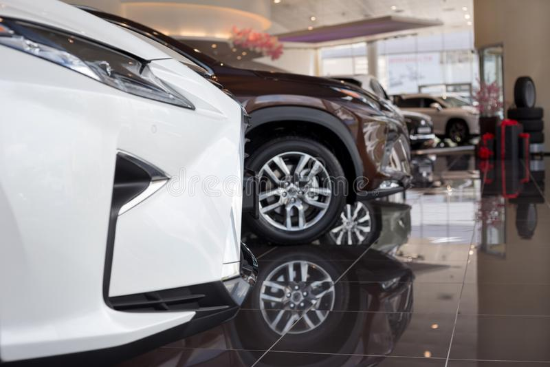 Car auto dealership. New cars at dealer showroom. Prestigious vehicles. Themed blur background with bokeh effect royalty free stock photography
