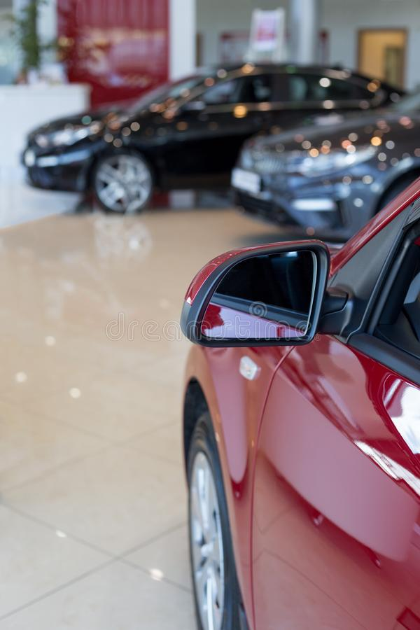 Car auto dealership. New cars at dealer showroom. Prestigious vehicles. Themed blur background with bokeh effect royalty free stock images