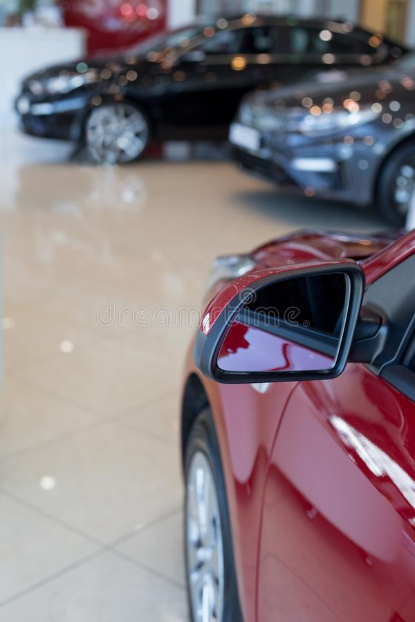 Car auto dealership. New cars at dealer showroom. Prestigious vehicles. Themed blur background with bokeh effect royalty free stock photos
