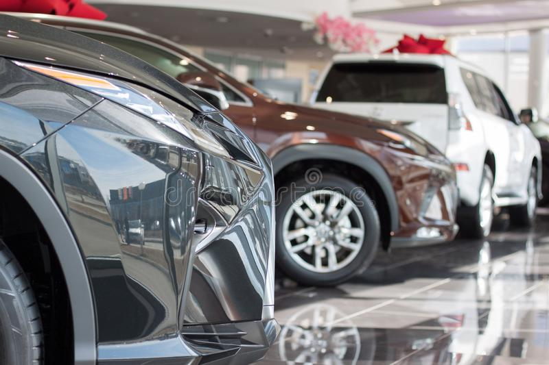 Car auto dealership.Themed blur background with bokeh effect. New cars at dealer showroom. Car auto dealership. Themed blur background with bokeh effect. New royalty free stock photo