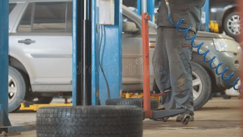 Car auto service working - mechanic under the car stock image