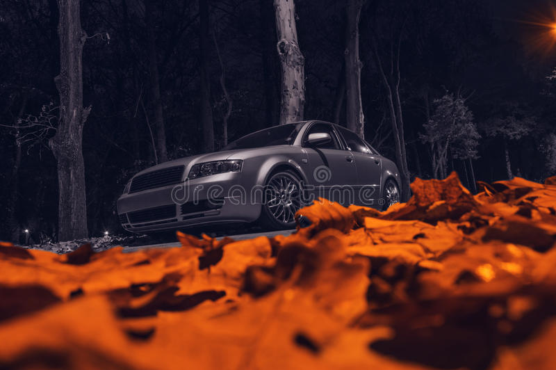 Car in autumn night royalty free stock photo