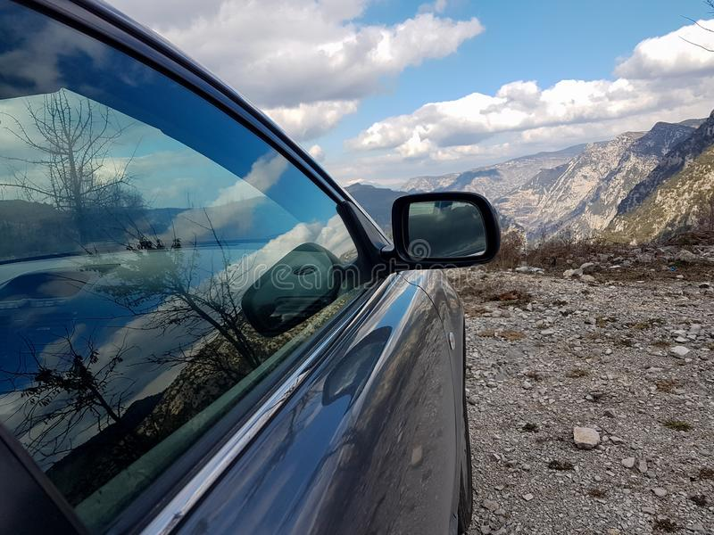 Car back doors wheels sky clouds spring nature mountains adventrure. Colors royalty free stock photography