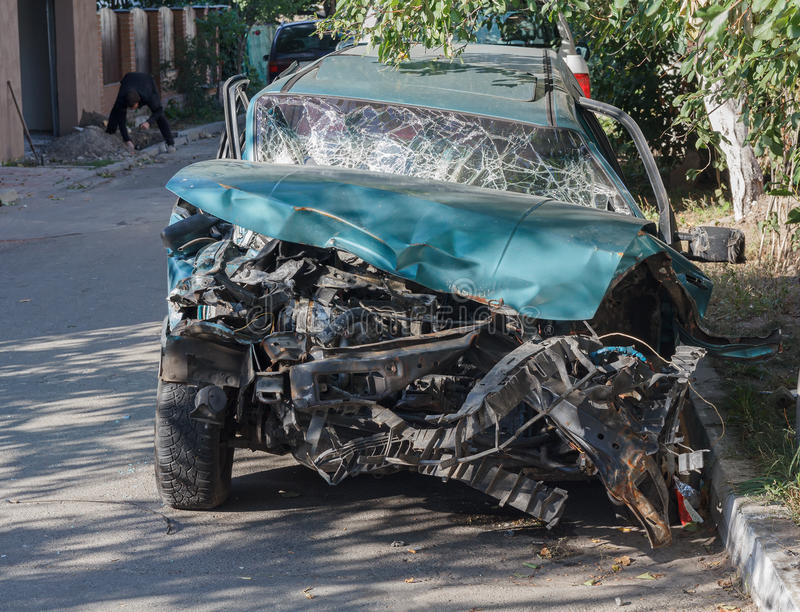 Car badly damaged as a result of a traffic accident. Transport stock photo